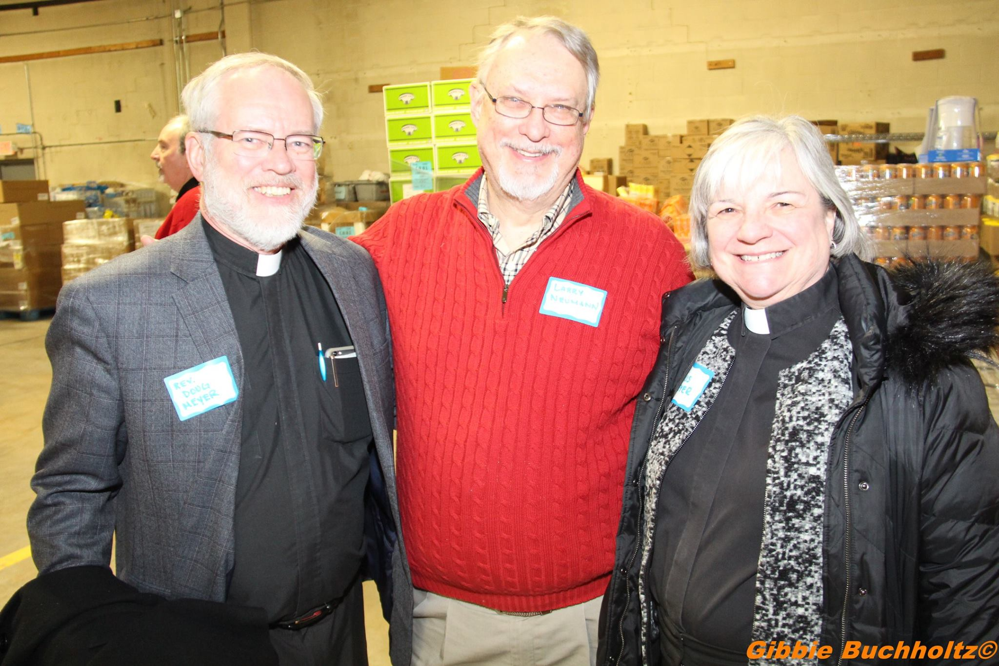 Pastors Doug and Chris Meyer, Lutheran Church of the Holy Spirit with COOL President Larry Neumanmn